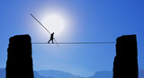 Tightrope Walker Balancing on the Rope - 89084316