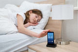 Girl On Bed Snoozing Mobile Phone Alarm poster