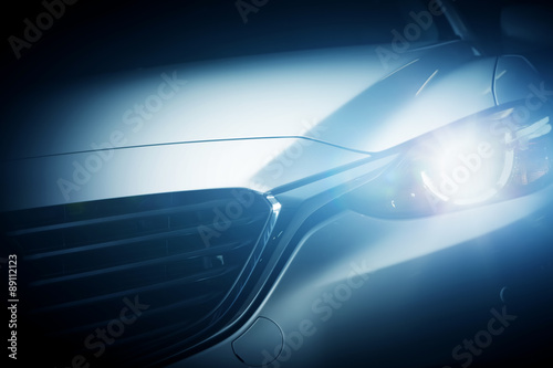 Fotografiet Modern luxury car close-up background