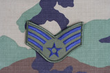 KIEV, UKRAINE - June 6, 2015.US AIR FORCE Senior Airman rank patch on woodland camouflage uniform poster