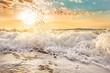 Splashes of wave at sunrise.