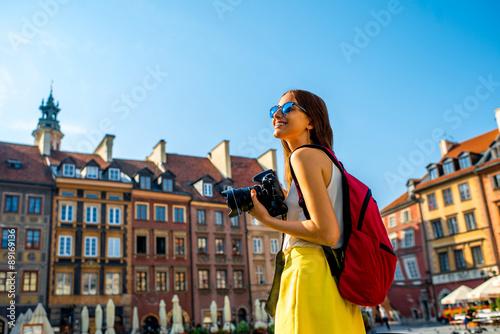 Female traveler in Warsaw's old town