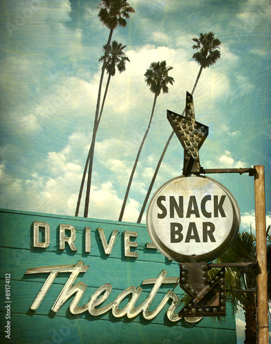 Poster aged and worn vintage photo of drive in theater and snack bar sign
