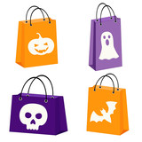 set of four Halloween bags with images of a bat, sull, jack-o-lantern and a ghost