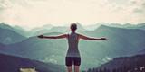 Fototapety Woman celebrating nature and reaching the summit