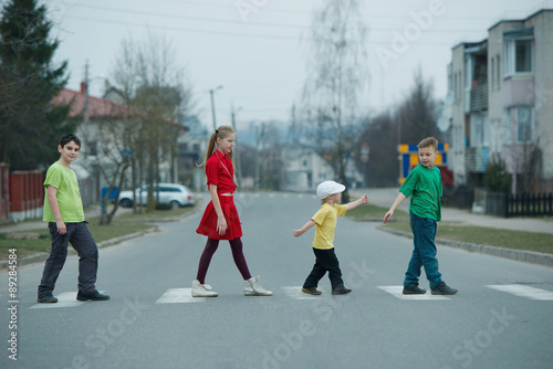Poster children crossing street on crosswalk