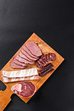 deer meat and sausage on cutting board