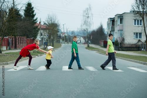 Poster children crossing street on crosswalk