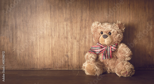 Teddy bear on a wooden shelf