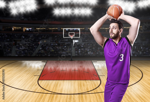 Poster Basketball Player on a purple uniform in basketball court