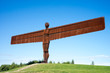 Angel of the North with a blue sky.  There are no people in shot, making the Angel completely isolated.
