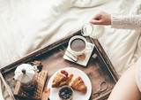 Fototapety Woman having breakfast in bed. Window light