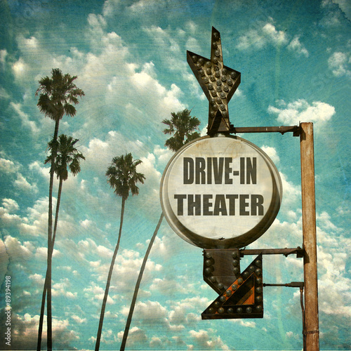 Poster aged and worn vintage photo of retro drive in theater sign