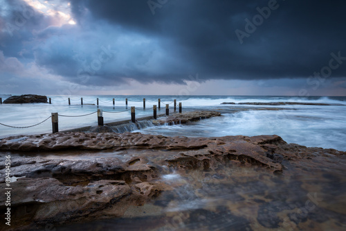 Plagát, Obraz Cloudy seascape at Maroubra rock pool, Sydney, Australia.