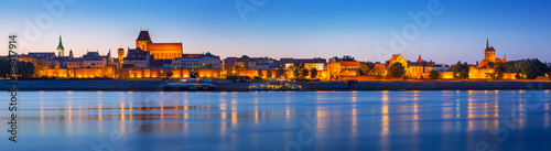 Fototapeta Panorama of Torun at night reflected in Vistula river, Poland
