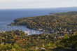 View of Camden with fall colors from Mount Battie.coastal Maine