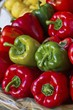 Various different coloured peppers in a basket - 89492702