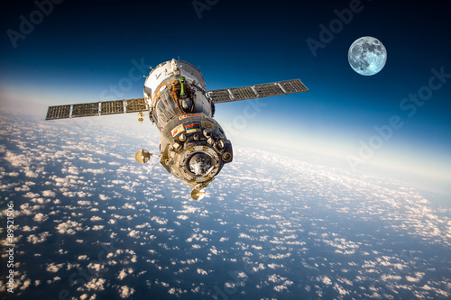 Foto op Canvas Spacecraft Soyuz over the planet earth