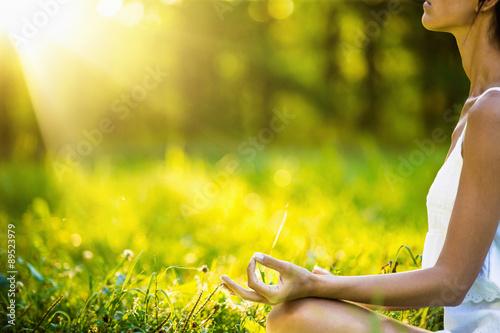 Leinwandbild Motiv Yoga woman meditating at sunset
