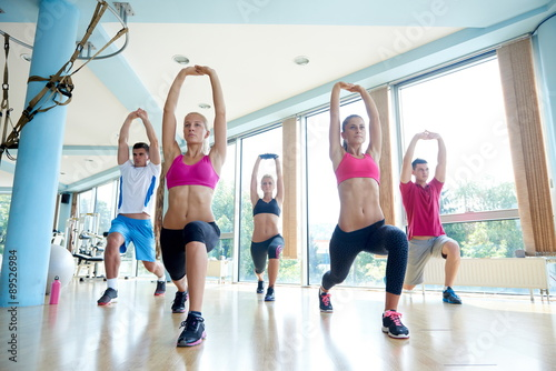 obraz lub plakat group of people working out in a fitness gym