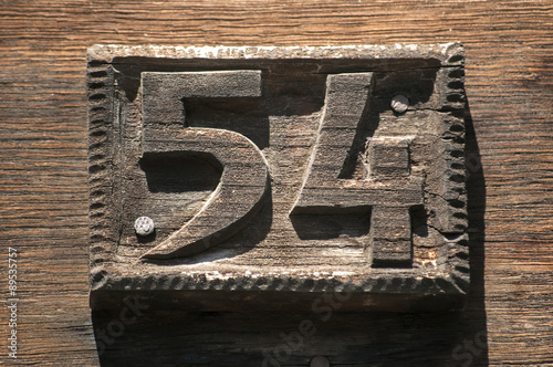 Poster Old retro weathered carved wooden home plate with number 54