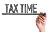 Hand with marker writing the word Tax Time