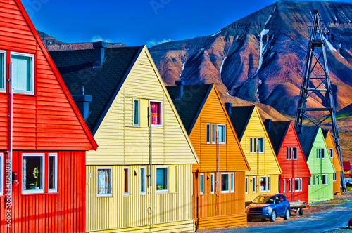 Digitally enhanced row of very colorful homes in Svalsbard, Norw