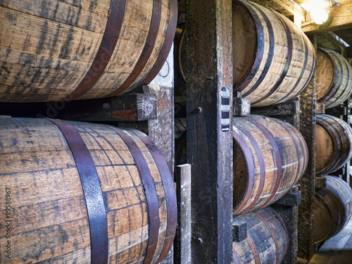 Barrels maturing Bourbon in Distillery in Bardstown Kentucky USA Poster