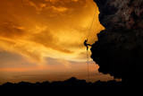 Fototapety Rock Climber at Sunset