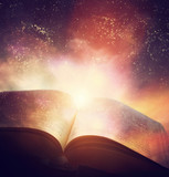 Fototapety Open old book merged with magic galaxy sky, stars. Literature, horoscope