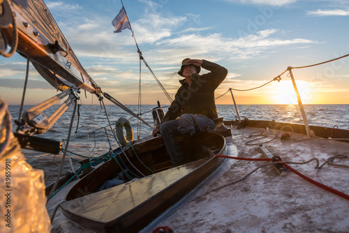 Senior retired sailing Buenos Aires River to Uruguay. Sport free