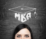 A head of young brunette lady who is thinking about MBA degree. Drawn a graduation hat on the black chalkboard background . poster
