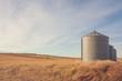 Autumn landscape of grain silos in a farmer's field.