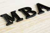 MBA (or Master of Business Administration) sign on wood background poster