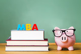 MBA degree theme with textbooks and piggy bank poster