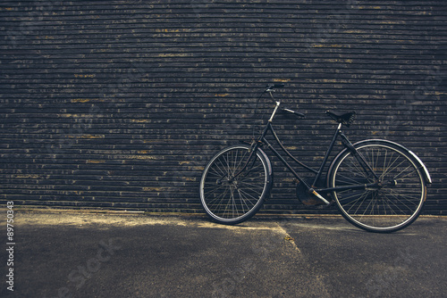 Fotobehang Fiets Classic Vintage Black Hipster Bicycle on the Street