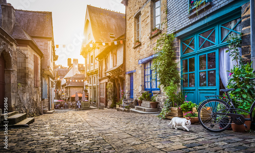 Fototapety, obrazy : Old town in Europe at sunset with retro vintage Instagram style filter and lens flare effect