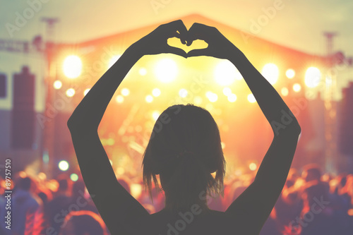 Silhouette of a girl while enjoying the concert.