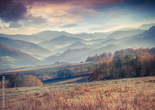 Misty autumn morning in the Carpathian mountains. - 89766586