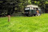 Fototapety Vintage Camping Van on Meadow in Forest.