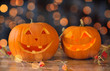 close up of carved halloween pumpkins on table