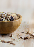 Close-up of Muesli and granola in blurred wooden background. (Shallow aperture intended for  the aesthetic quality of the blur.) poster
