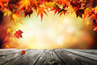 Autumn background with red leaves wooden planks