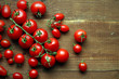 fresh farm tomatoes on wooden background
