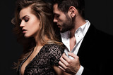 Sexy elegant couple in the tender passion. Beautiful woman near the man.