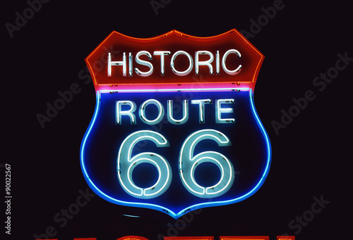 Canvas Route 66 This is a road sign that says Historic Route 66. It is a neon sign in red, white and blue against a black night sky.