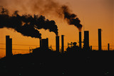 This is a Ford factory at sunset. These are smokestacks contributing to the pollution in the air.