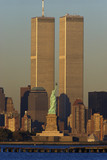 These are the World Trade Towers and Statue of Liberty at sunset. It is the view from New Jersey. - 90030335
