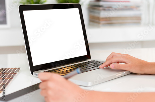 Woman hands working with computer. Laptop with blank screen