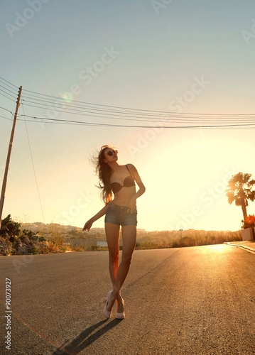 Foto op Aluminium Exclusieve woman in bikini on the street